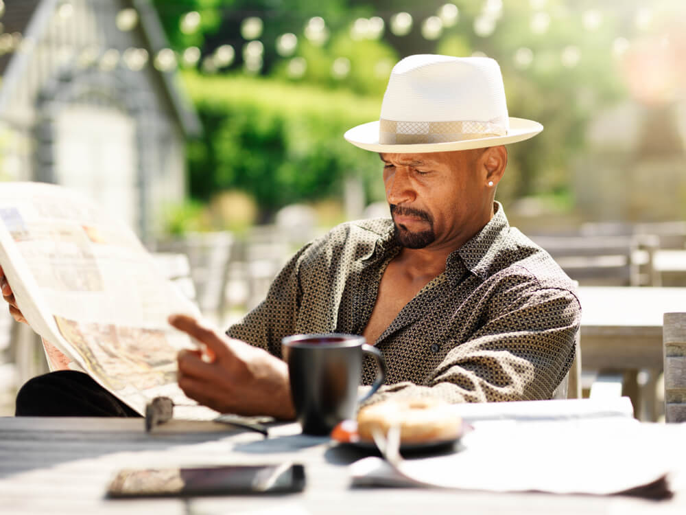 Man in his 40s or 50s reading the newspaper