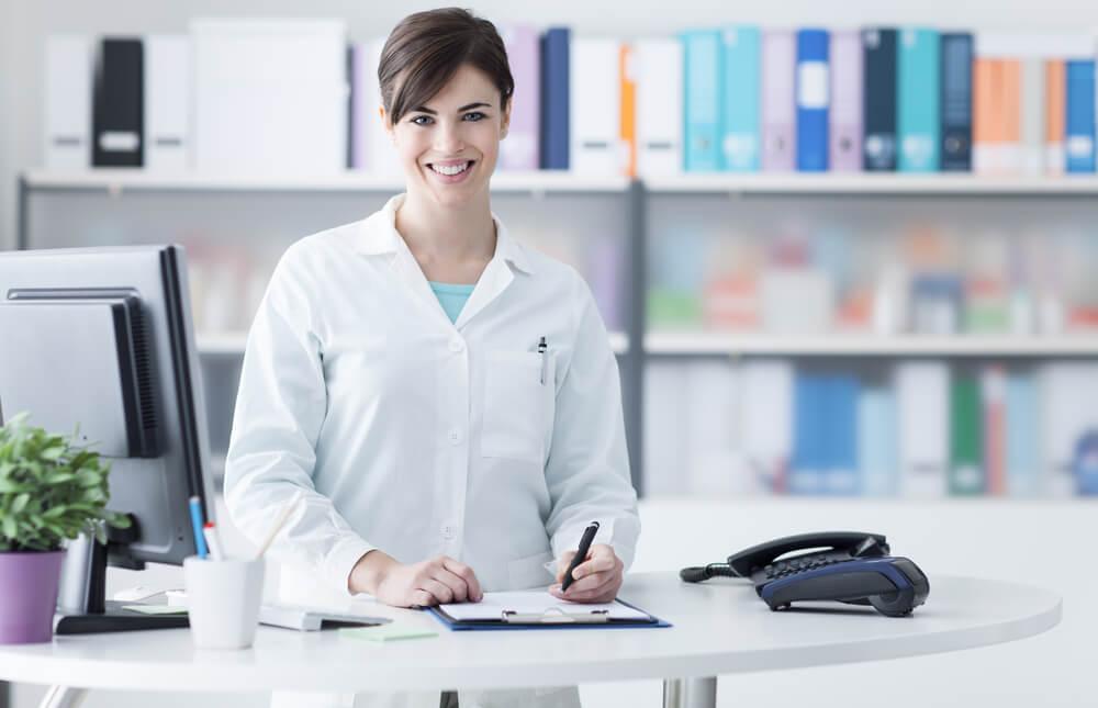 Doctor at checkin desk at medical office