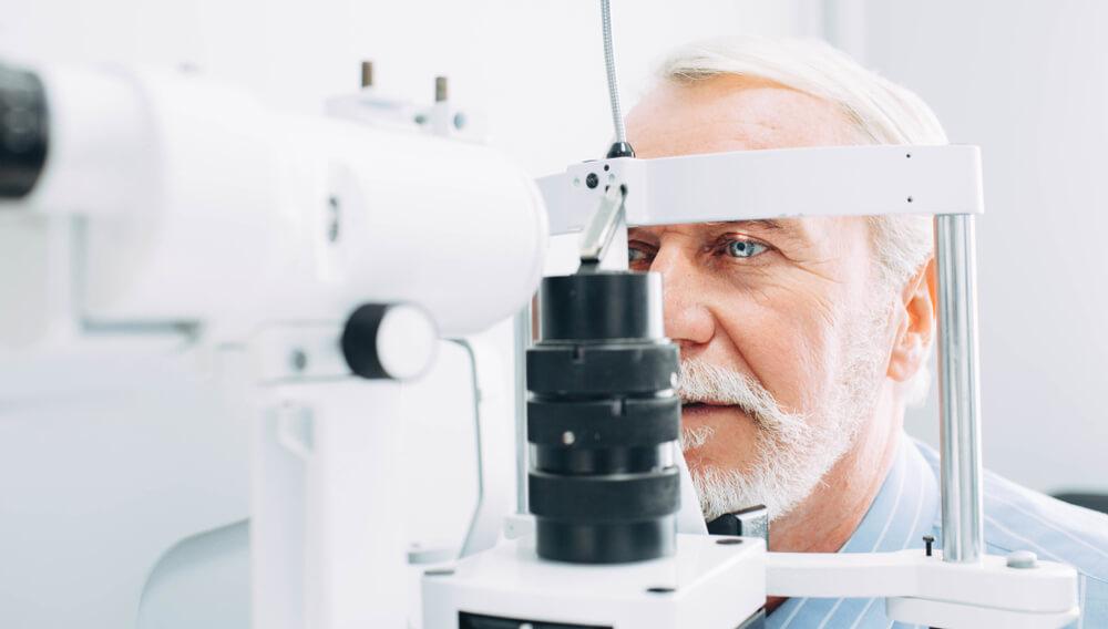 Senior man getting an eye exam