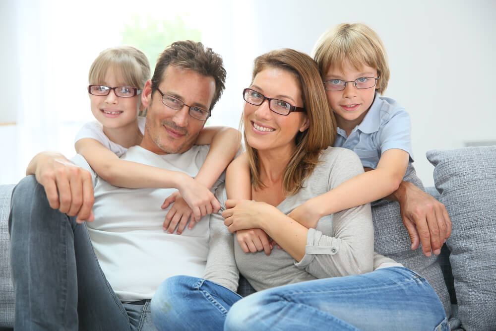 Happy family all wearing glasses